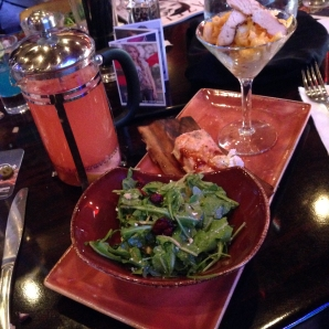 Grilled chicken arugula salad, grilled Norweigan salmon, and twisted mac, chicken, and cheese (front to back) served with a pitcher of the red berry press.