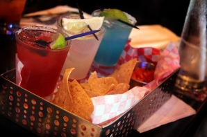 Air Mexico-flight of three margaritas including cucumber, red berry, and blue curacao served with chips and homemade salsa