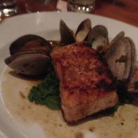 Sturgeon, clams, mustard greens, and lobster broth